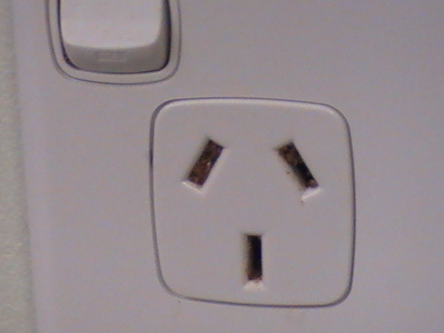 A power point with termite mudding in the pin sockets